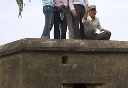 Vietnamese kids on top of an old bunker