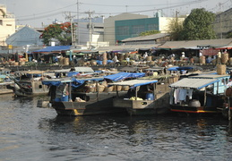 boats along a riverside market