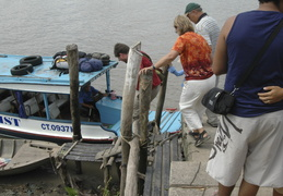 boarding another boat on the Meekong