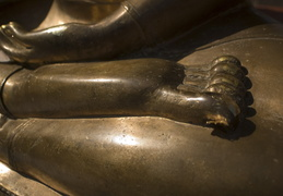 Buddha's feet in a yoga pose