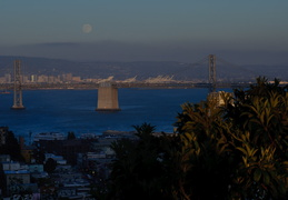 full moon rising over Bay Bridge